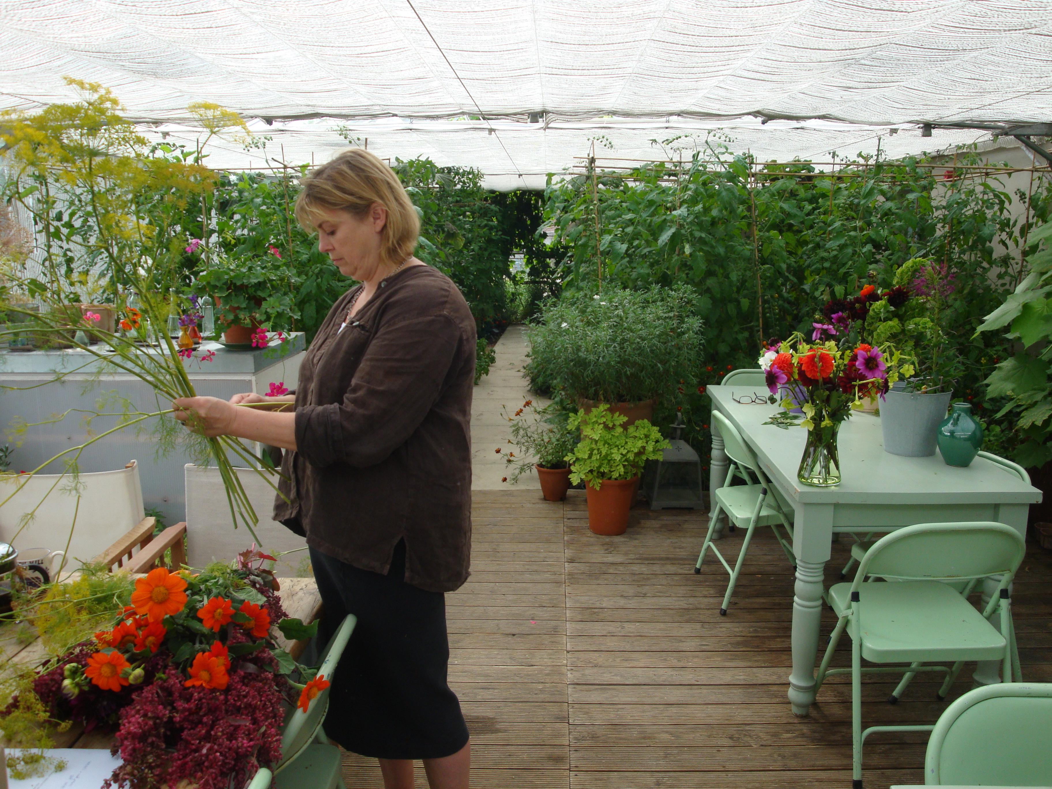 Sarah Raven creating an arrangement